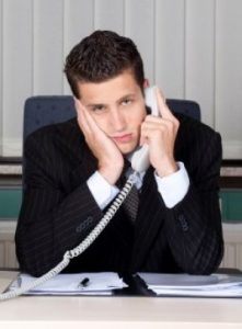 Man looking bored on the telephone
